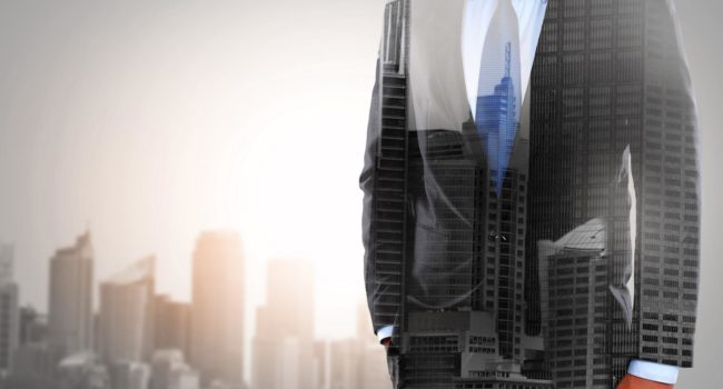 concept of double exposure businessman and city