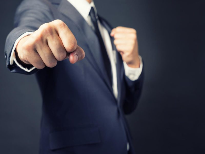 Businessman Punch ready to fight in work. photo in retro style for magazine,web design